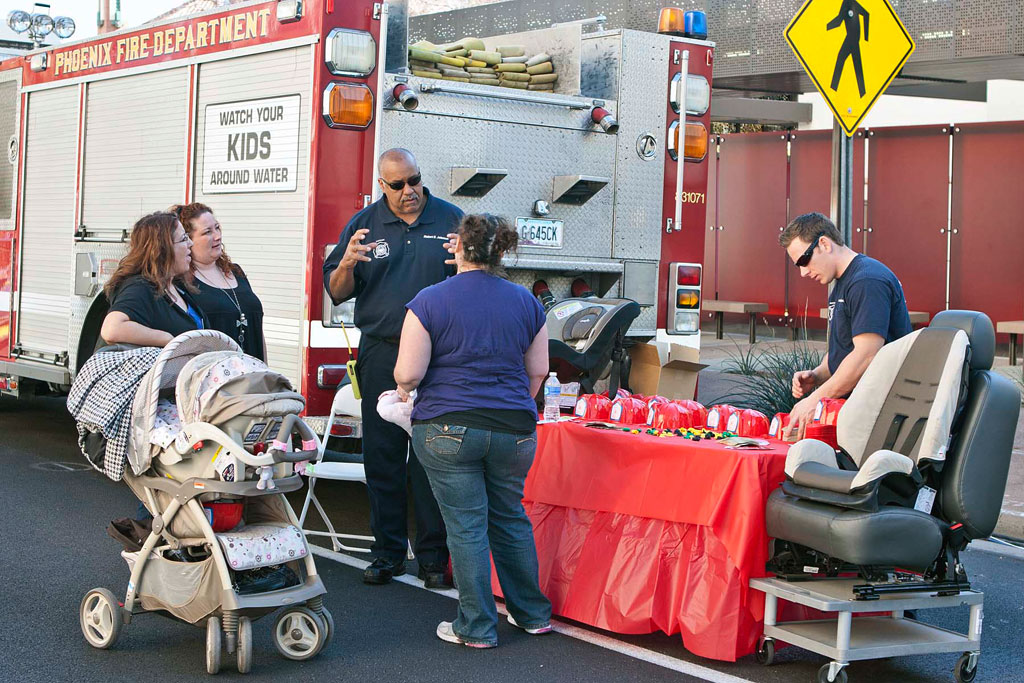 Phoenix firefighters at a child safety seat event