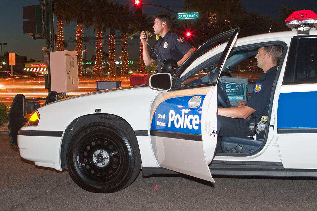 Phoenix Police officer in patrol vehicle