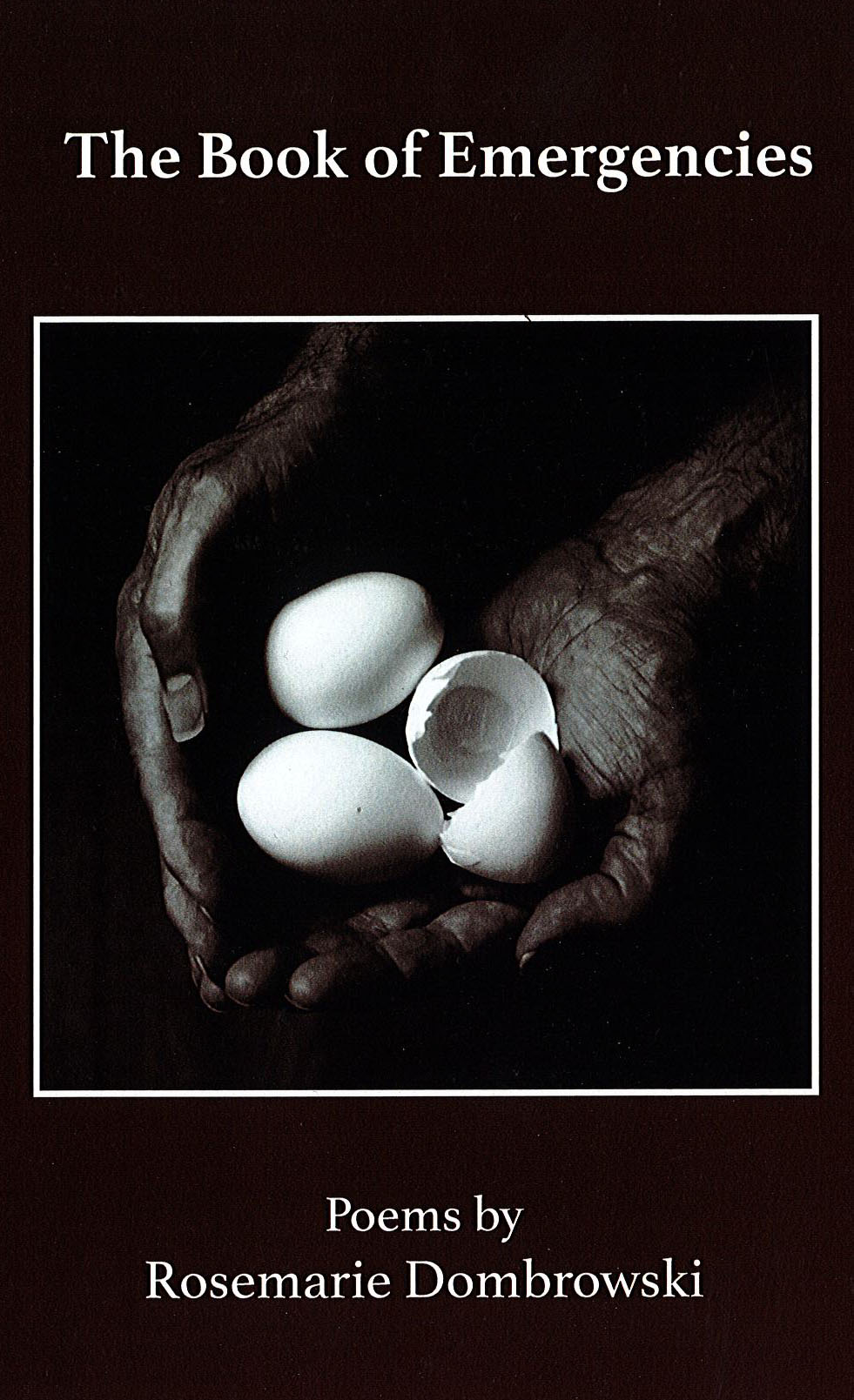 Cover of The Book of emergencies: Hands holding egg shells, one broken