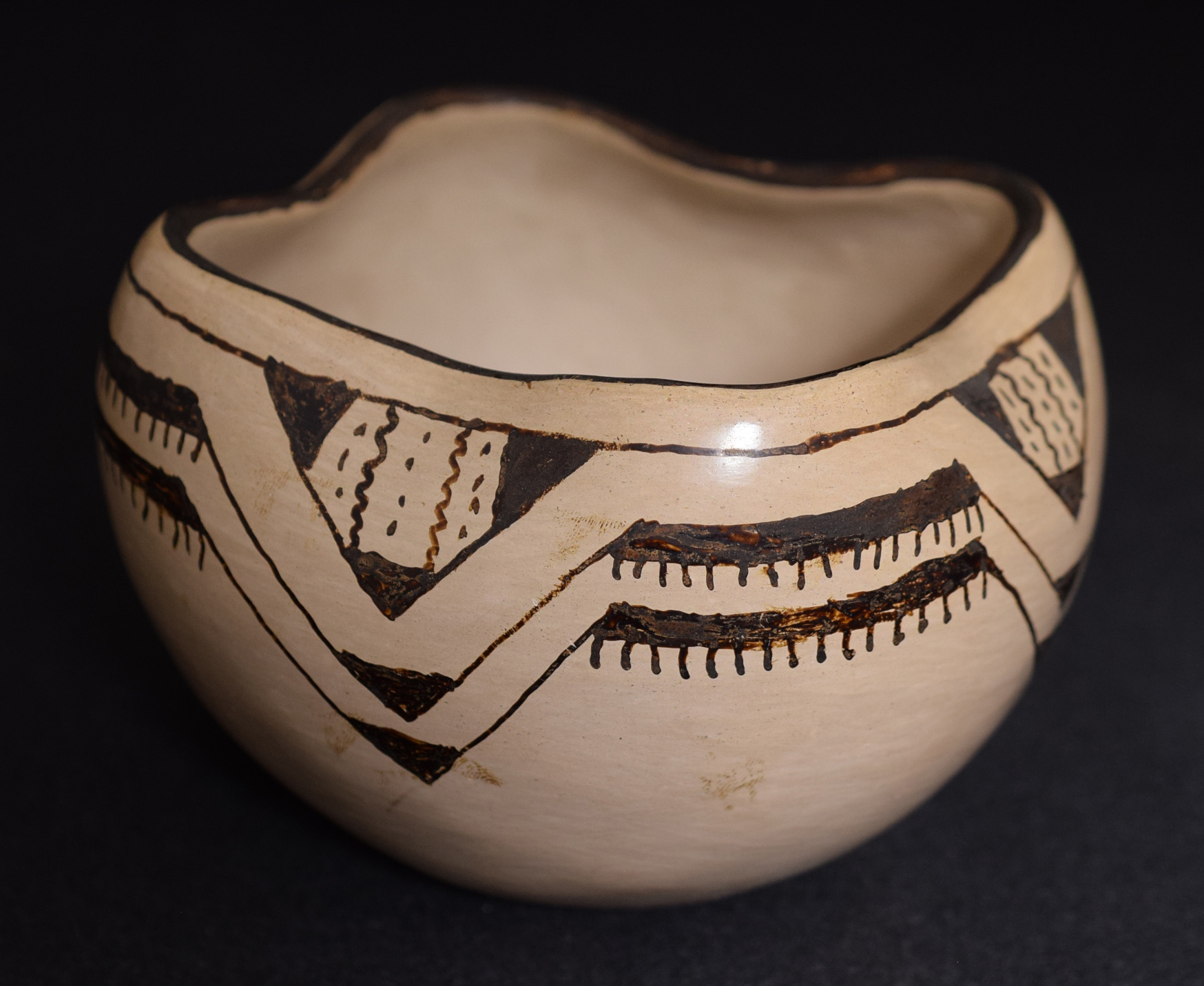 Pee-Posh pottery collection, bowl with geometric design