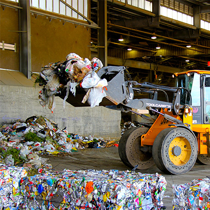 Public Works staff recycles materials at one of the Transfer Stations