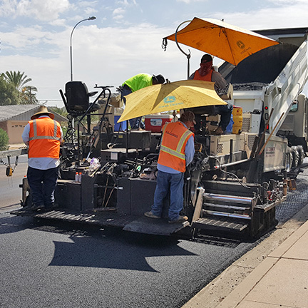 Street Transportation staff paving a street