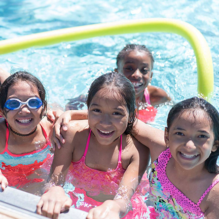 Kids gather poolside at a Phoenix public pool