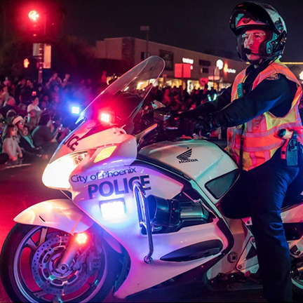 Phoenix Police riding along in the APS Electric Light Parade