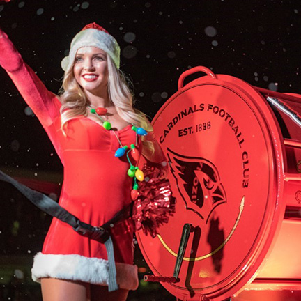Arizona Cardinal cheerleader marching in the APS Electric Light Parade