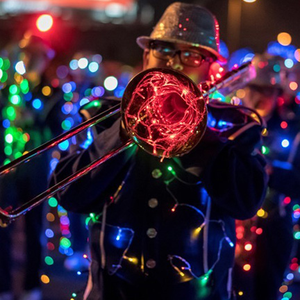 A decorated marching band in the APS Electric Light Parade
