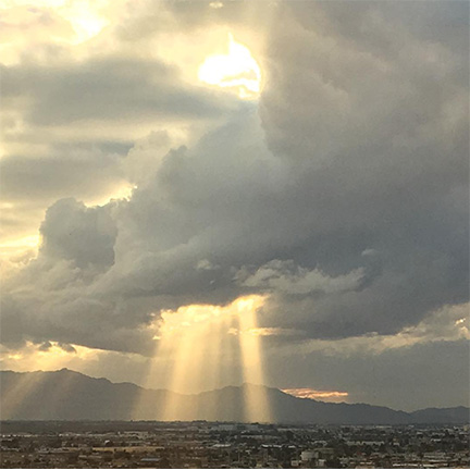 Sunlight burst through monsoon clouds