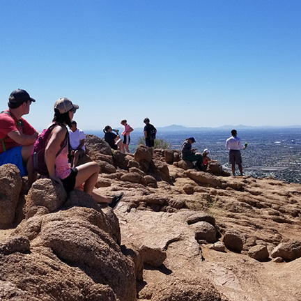 Hikers enjoying the sun on top of Camelback Mountain