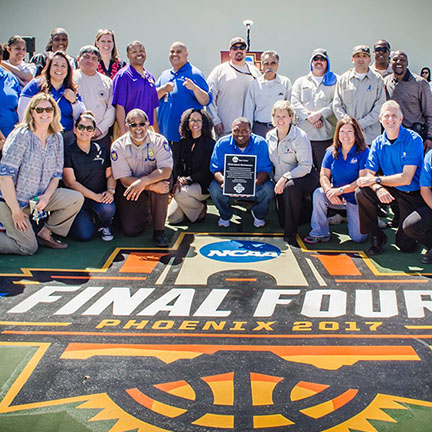 City staff at the opening of a refurbished basketball court