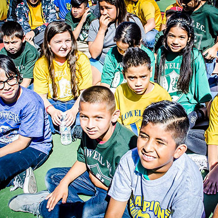 Youth at the refurbished basketball court dedication