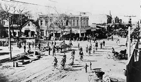 Photo of Cyclists at Washington and First Strees in late 1880s