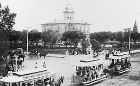 Photo of horse-drawn streetcar by old courthouse in 1890s