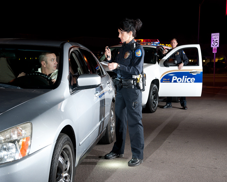 Police reserve officer at night traffic stop
