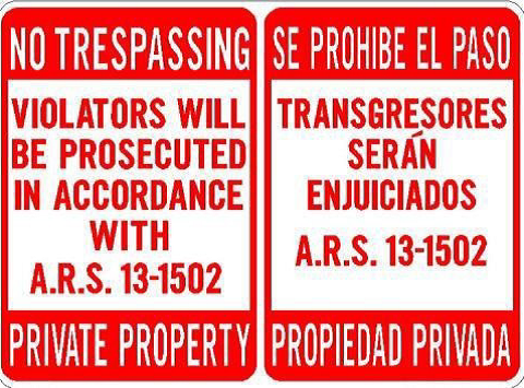 No tresspassing sign examples in English and Spanish.