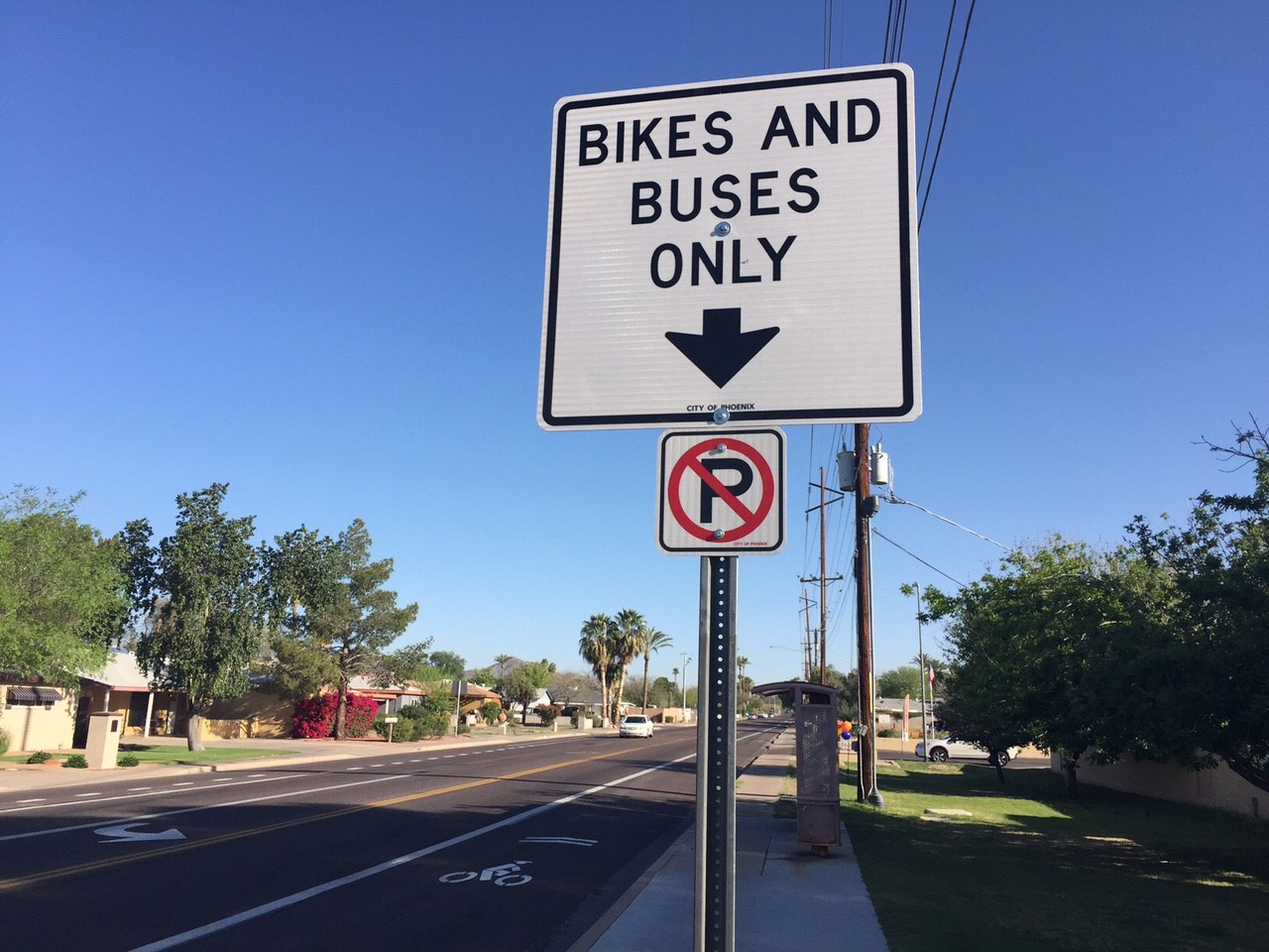 Sign saying bikes and buses only