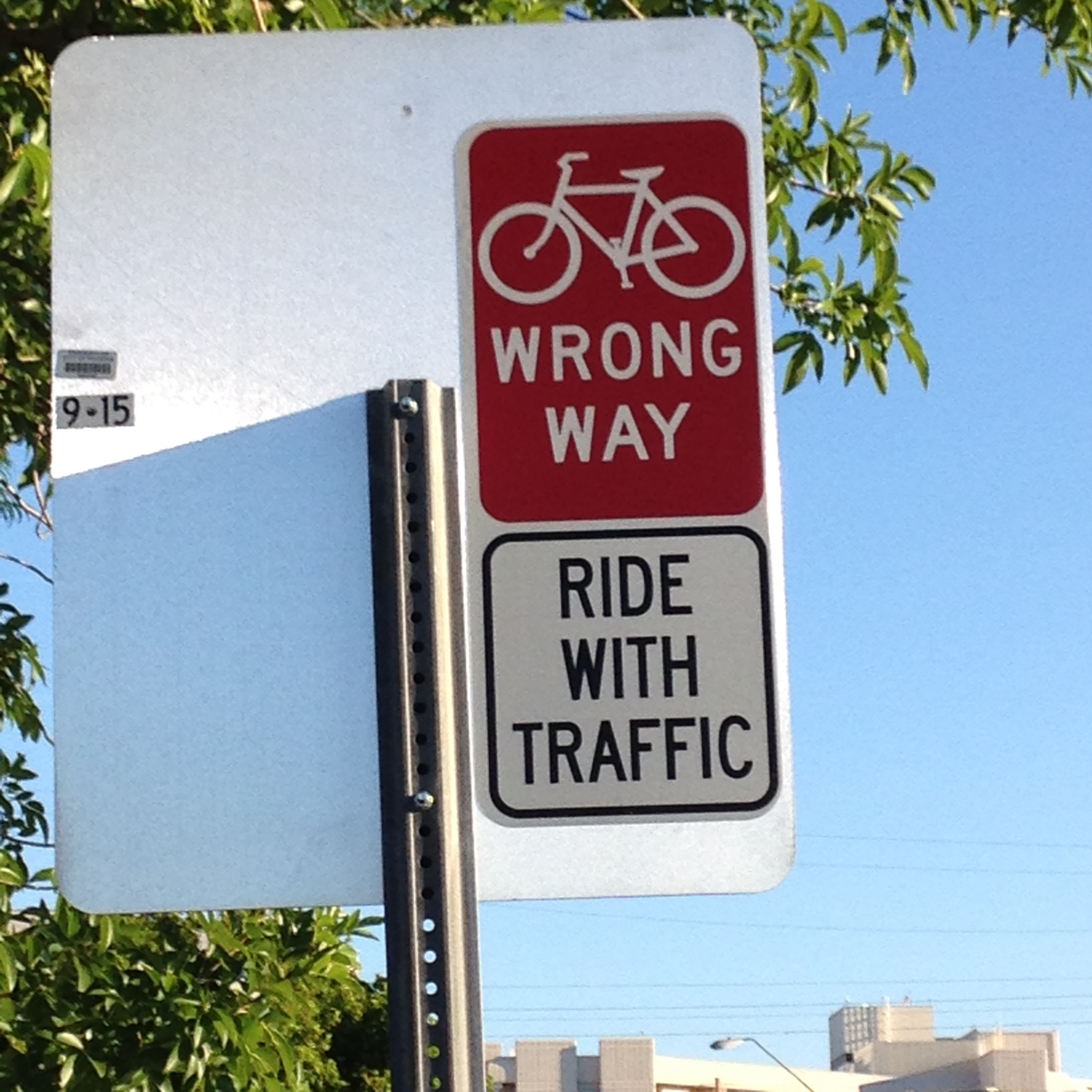 Wrong way bike sign, says Ride with Traffic