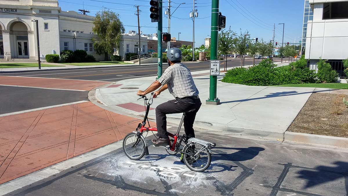Bicycle detection sumbol, person waiting on top of it.