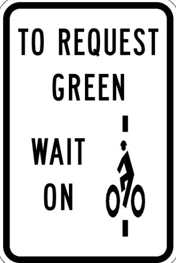 Bike wait sign, says To Request Green Wait On Bike Symbol
