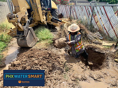 Digging a hole in ground for water pipe